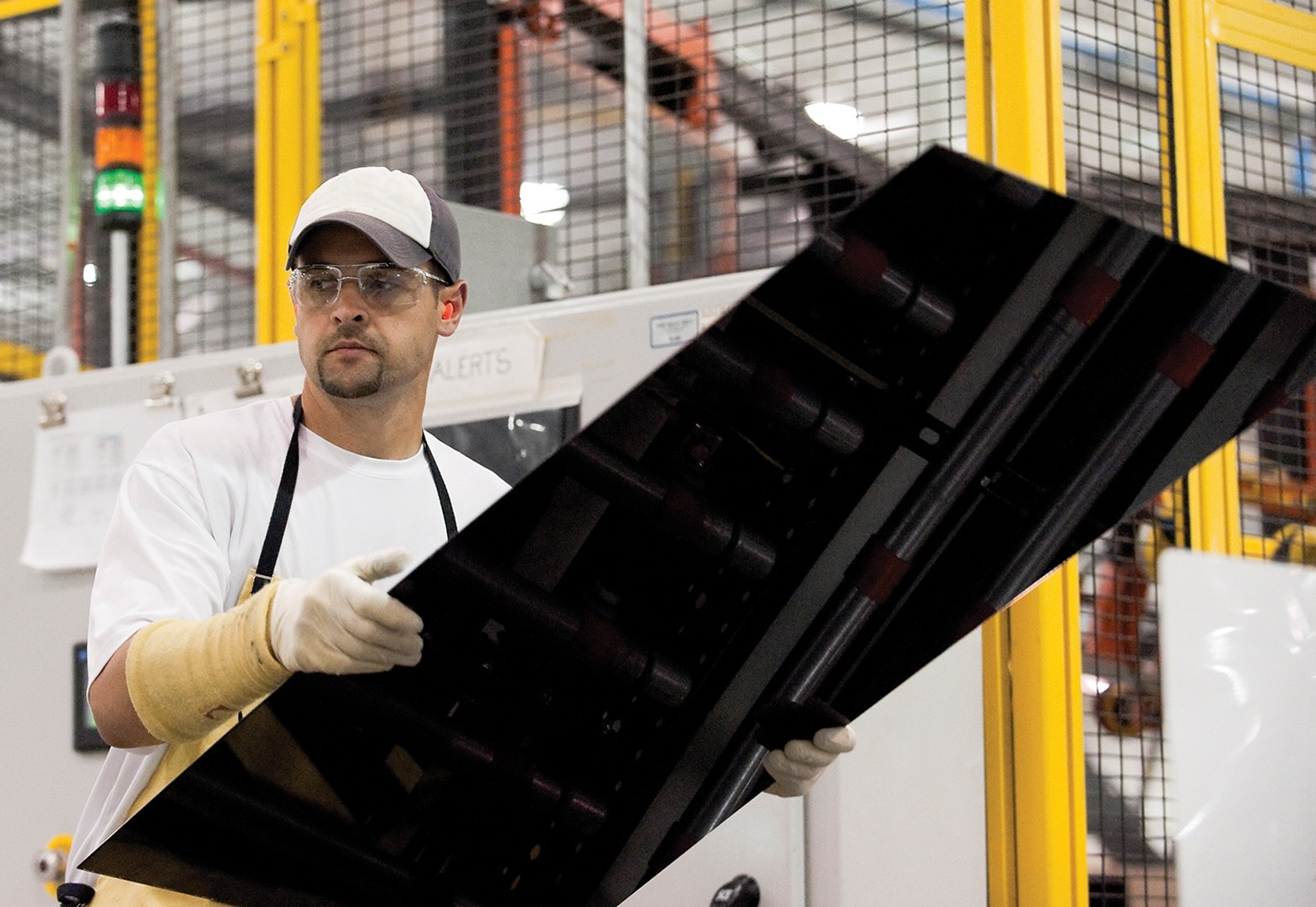 First Solar panel produced in a factory.