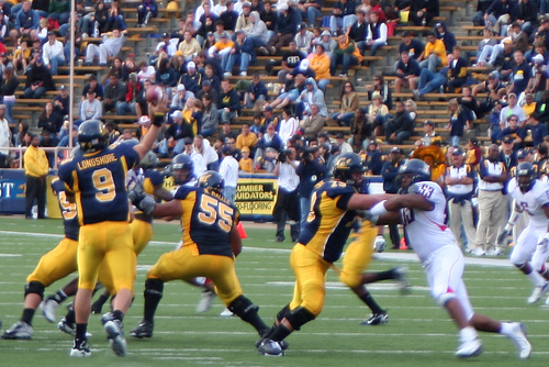 Football players go on the offense