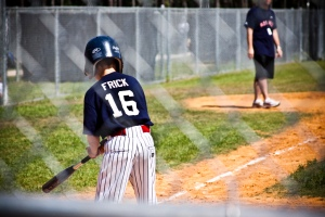Little league baseball player at bat
