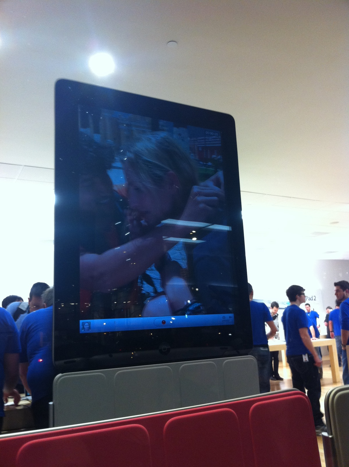 The iPad 2 on display in the store, with plenty of blue-shirts in the background. Photo by Megan Westerby.