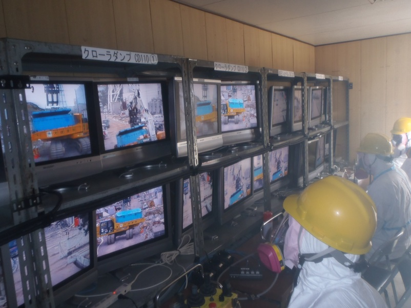 Workers Controlling the Remote Cleaners at Fukushima