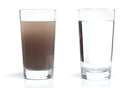 Clear and muddy water in two glasses