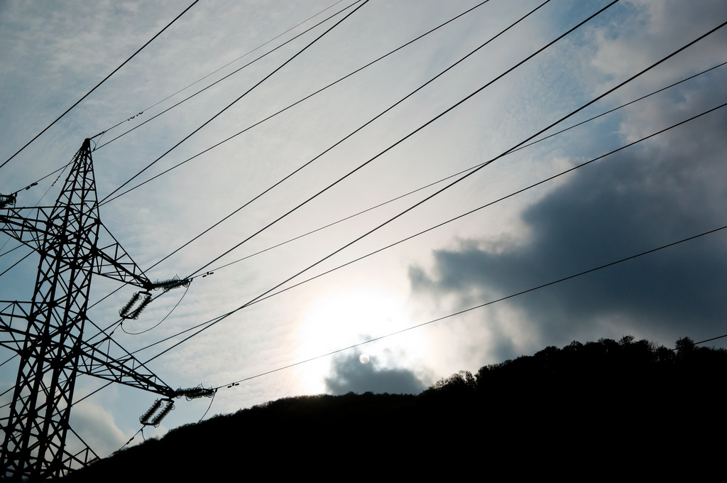 Power lines against bright sun
