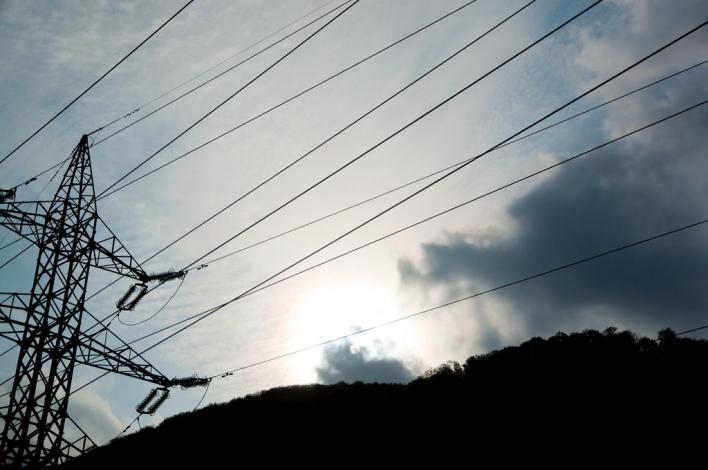 Power lines against bright sun