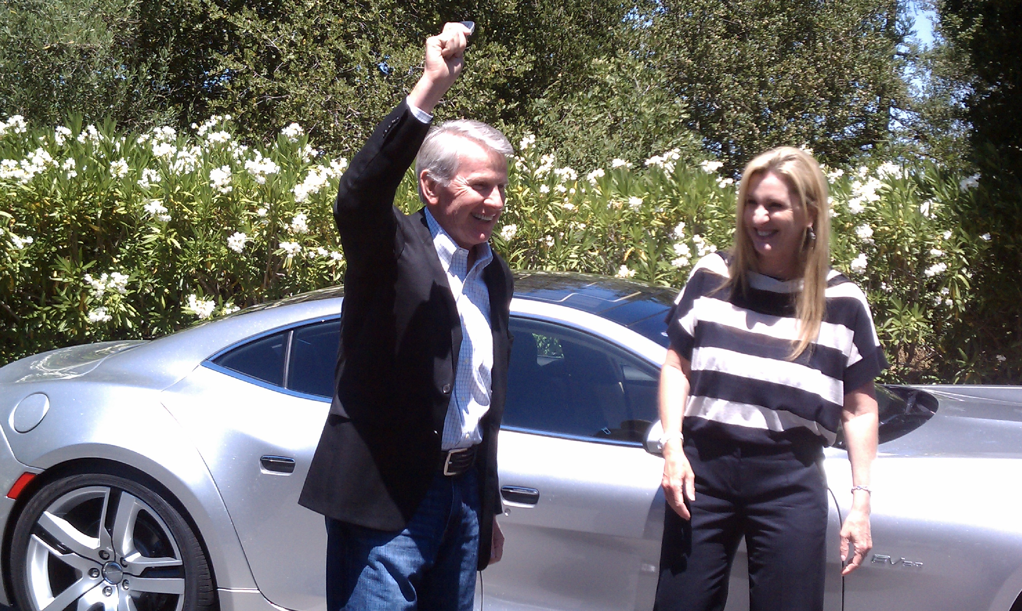 Kleiner Partner Ray Lane receives the keys for his Fisker Karma.