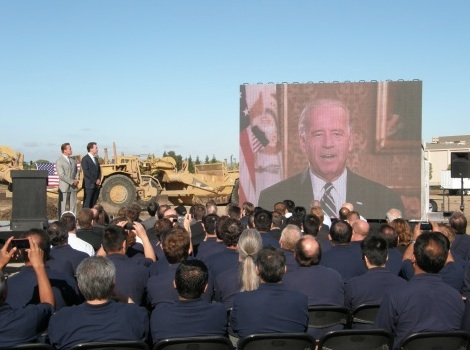 Solyndra's ground breaking ceremony in 2009, featuring a live video feed of Vice President Joe Biden. Image courtesy of Katie Fehrenbacher, Gigaom.