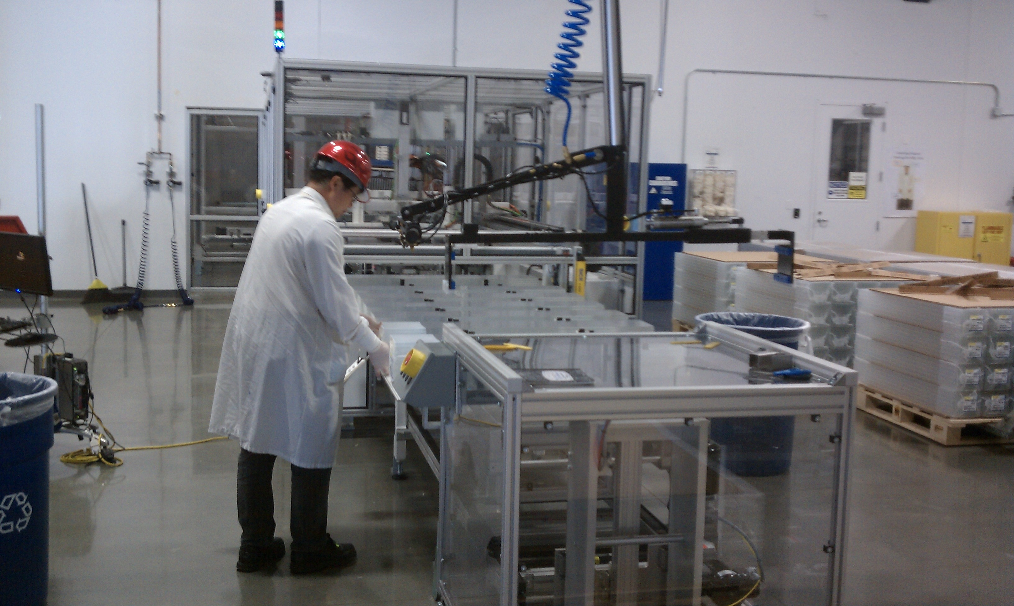Workers inspecting panels in Solyndra's factory in April