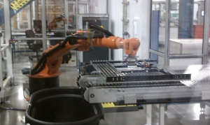 High tech robots moved Solyndra panels down the assembly line