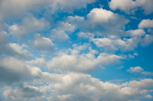 Bright clouds over blue sky