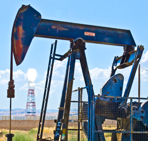 Coalinga Pumpjack and Lit Tower in the background