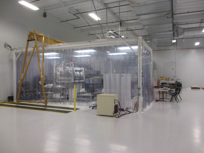 In one room, wafers will be be fed to equipment for growing a gallium-arsenide layer on top.