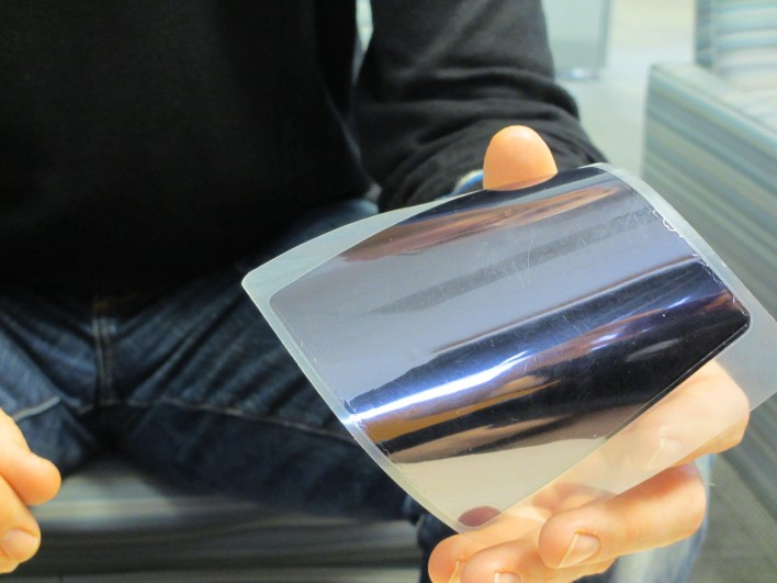Norris shows off the ultra-thin gallium-arsenide thin film.