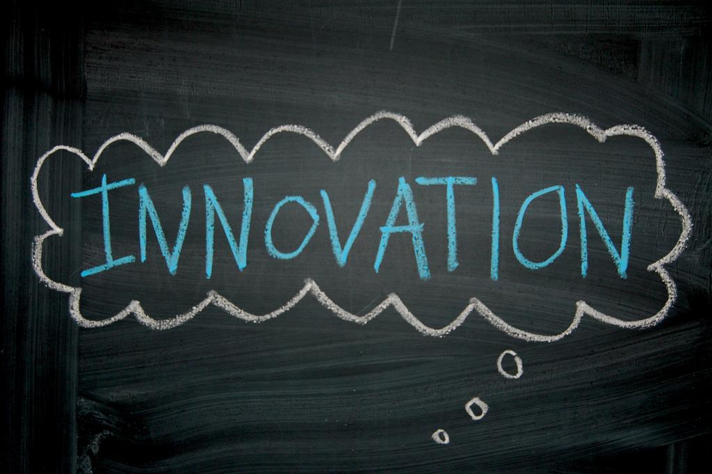 Innovation in a thought bubble written on a chalkboard