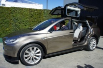 Tesla Model X with falcon wings fully open
