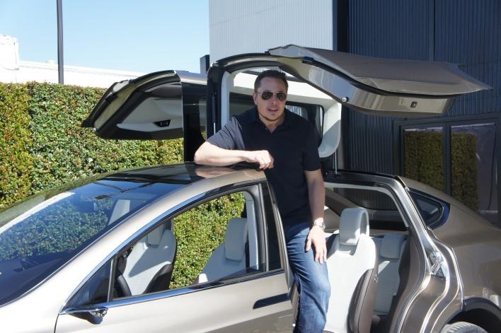 Elon Musk standing up in Model X