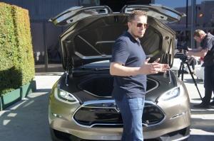 Elon Musk in front of the frunk