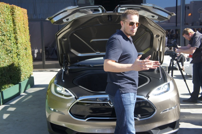 Elon Musk in front of the frunk