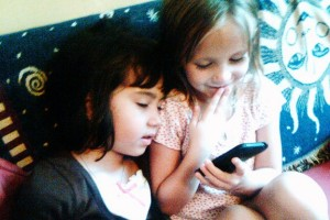 girls watching iphone