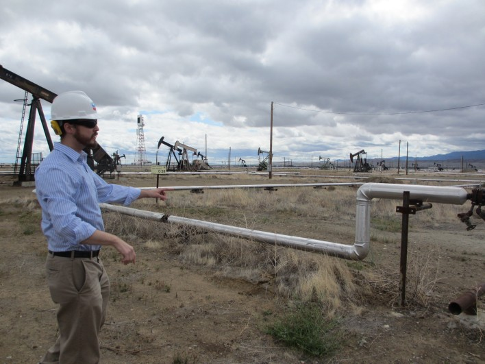 Petroleum engineer Daniel Emery explains the steam-piping system and how it helps to extract oil from the ground.