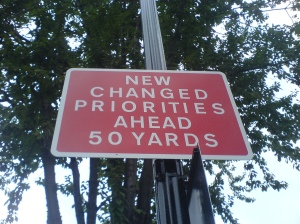 Sign: New changed priorities ahead 50 yards