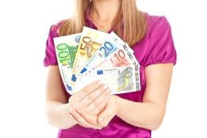 Woman holding wad of European euro money cash notes