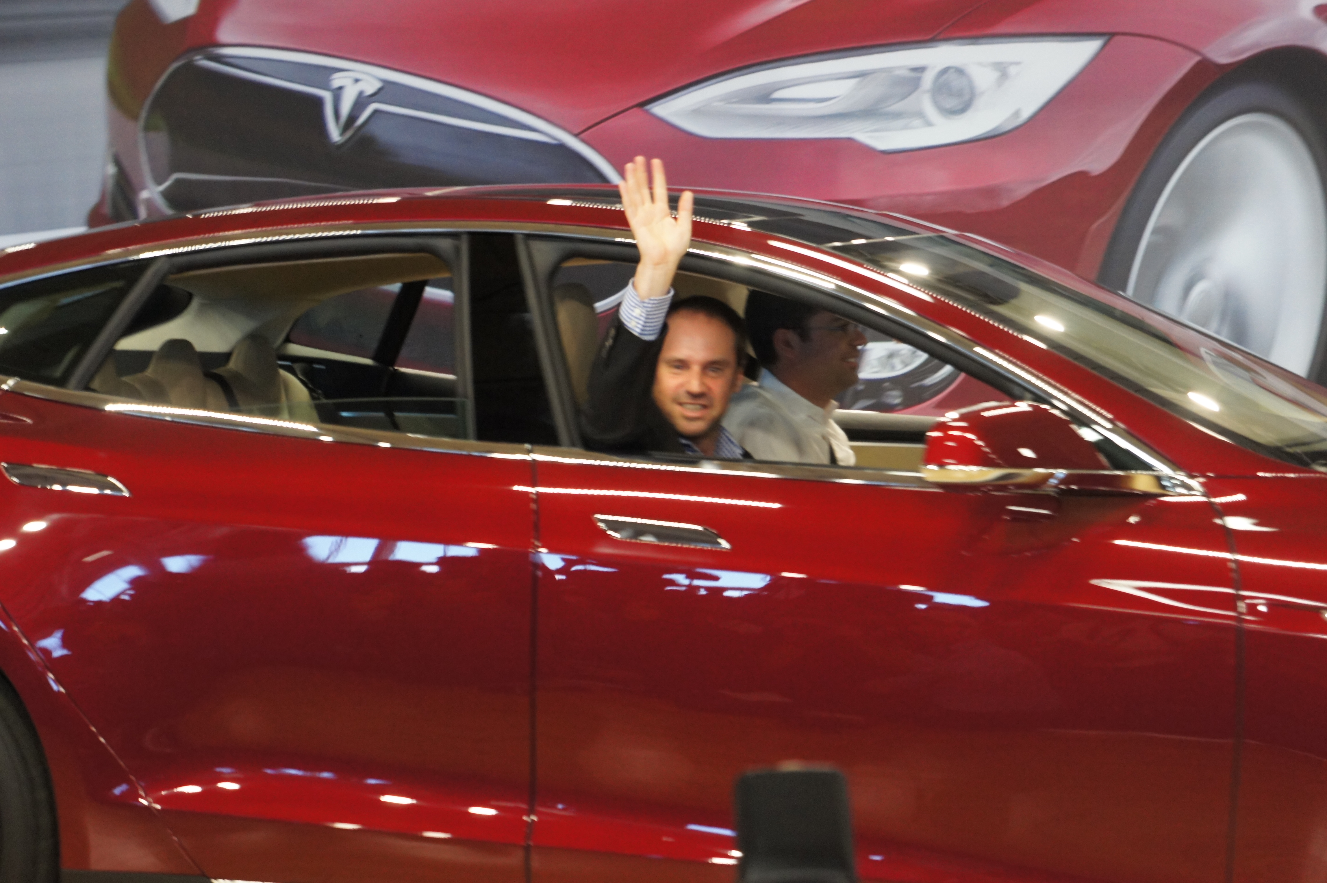 The first Model S customer is driven off