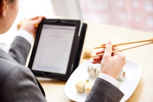 Tablet lunch sushi BYOD enterprise businesswoman