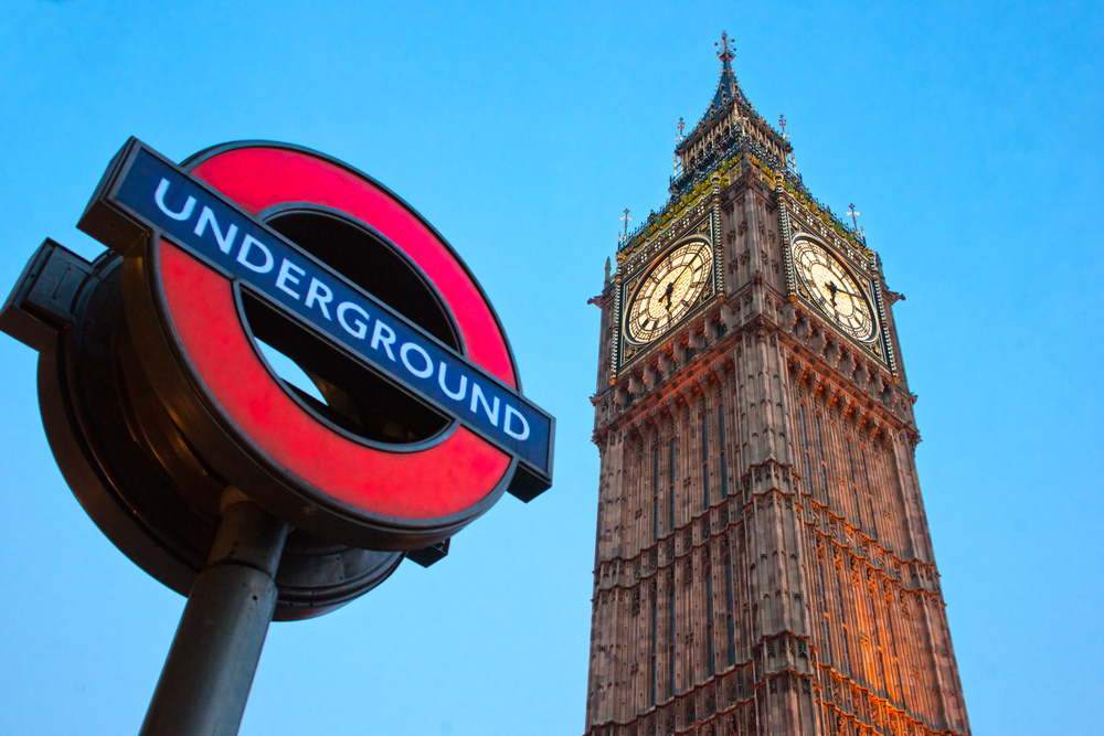 London Underground sign and Big Ben clock at Houses of Parliament