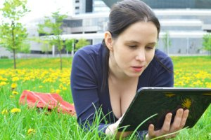woman with ipad, copyright shutterstock/ganko