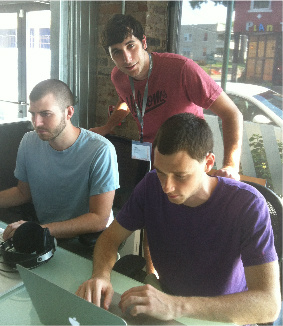 Travis Staton (l), Tony Gemayel (c) and TJ Weigel put final touches to their Demo Day presentation.