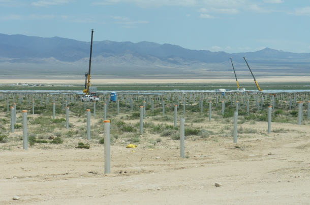 The mirrors are installed on poles throughout the desert