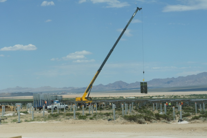 A crane placing a mirror into place at Ivanpah