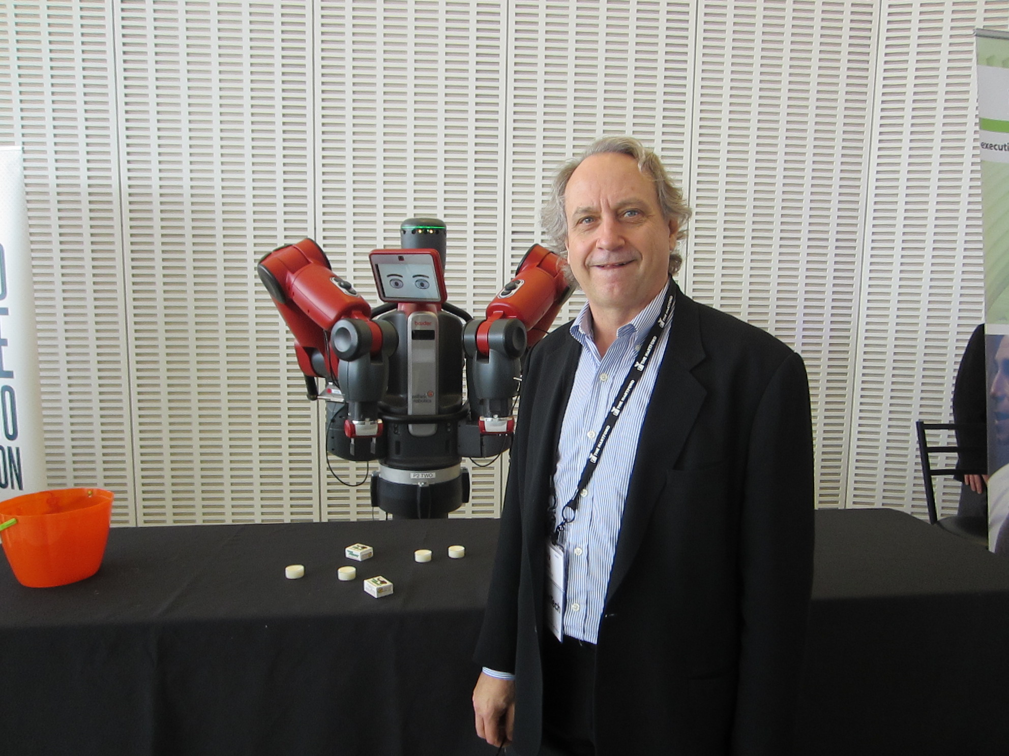 Baxter (left) with Rethink Robotics CEO Rodney Brooks.
