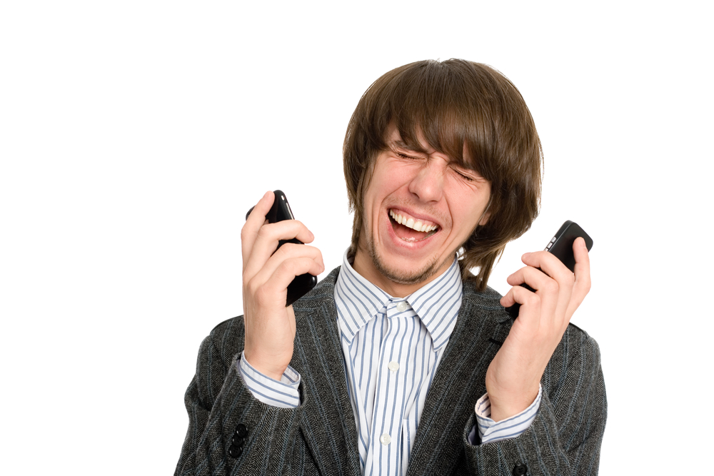 Man with two mobile phones smartphones