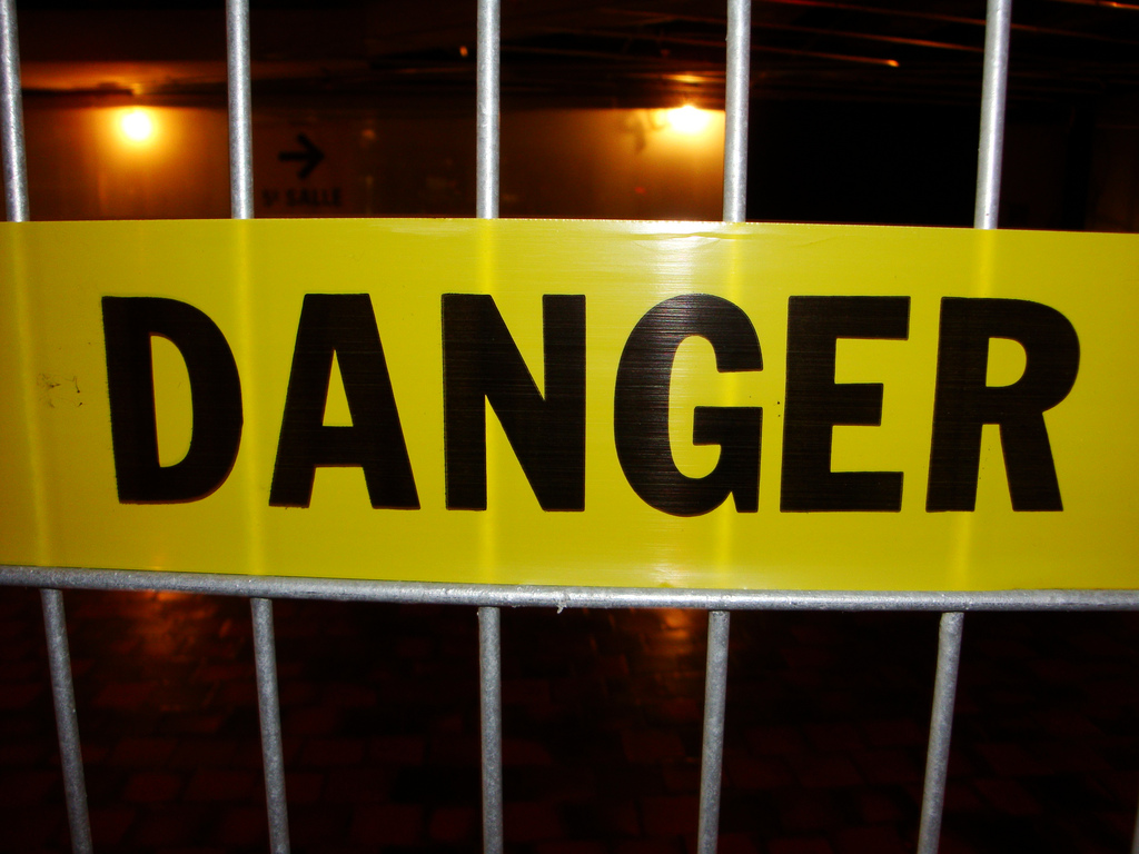danger caution sign warning proceed fence yellow tape