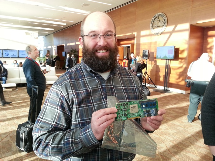 Frank Frankovsky of Facebook holding an AppliedMicro board at the January 2013 OCP event.