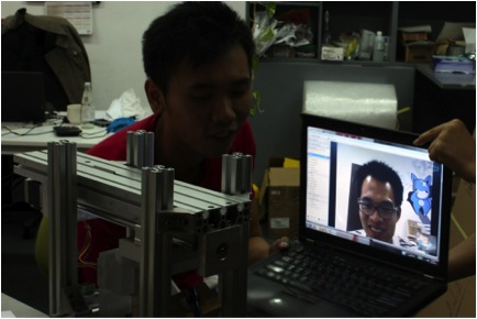 Haddock Invention and Manila Mantis Shrimp engineers use Skype to help address issues with a Solar Pocket Factory prototype. Photo courtesy: Ocean Invention Network