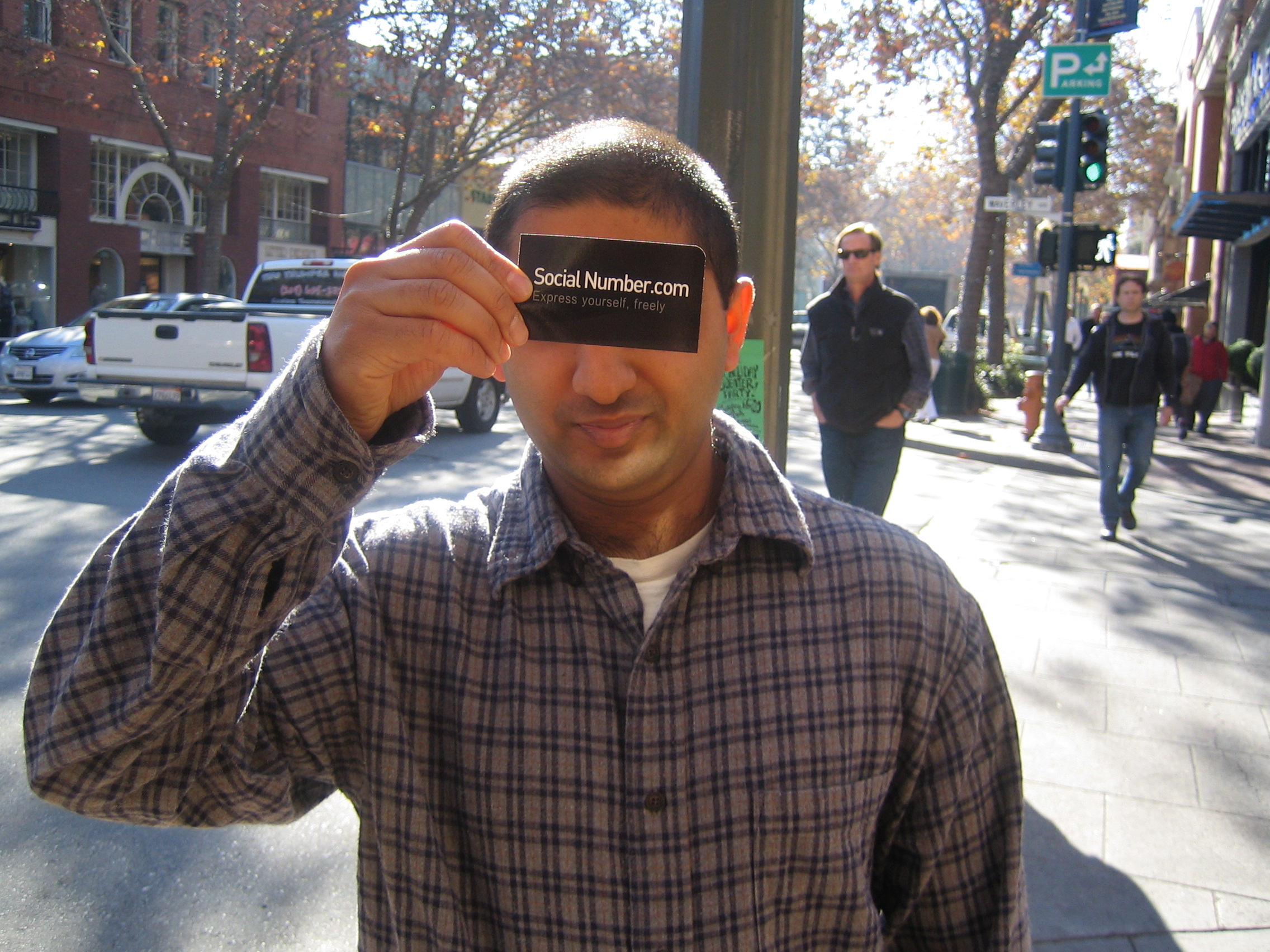 Social Number Stanford student holding business card anonymity