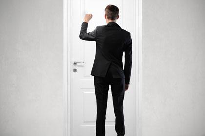 door knocking, used under license courtesy of Shutterstock/Ollyy