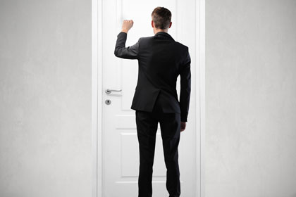 door knocking, used under license courtesy of Shutterstock/Ollyy