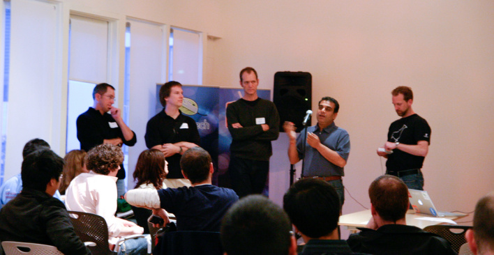 Cutting (center) flanked by Baldeschwieler and Om Malik at GigaOM's Hadoop Meetup in 2008.