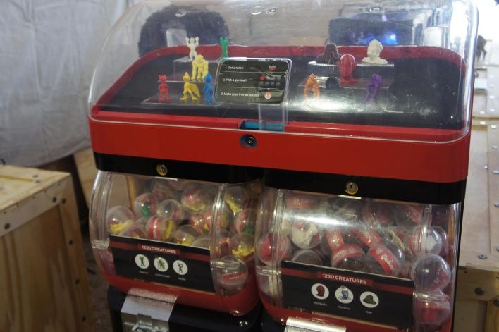 Vending machine dispensing 3D printed monsters, by MakerBot, Autodesk.
