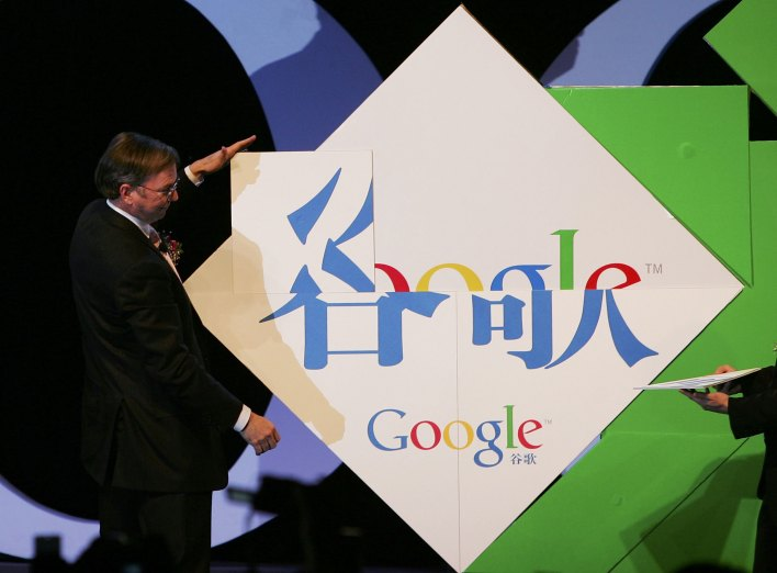 "During a 2006 trip to Beijing, Google chief executive Eric Schmidt spells Chinese characters ""Gu Ge"" at the inauguration of the company new Chinese brand name April 12, 2006 in Beijing, China. Google said it has adopted the Chinese-language brand name ""Gu Ge"" for its Chinese operations, with Google chief executive Eric Schmidt saying the new name demonstrated Google's commitment to China.  (Photo by Guang Niu/Getty Images)"