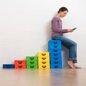 startup woman five boxes