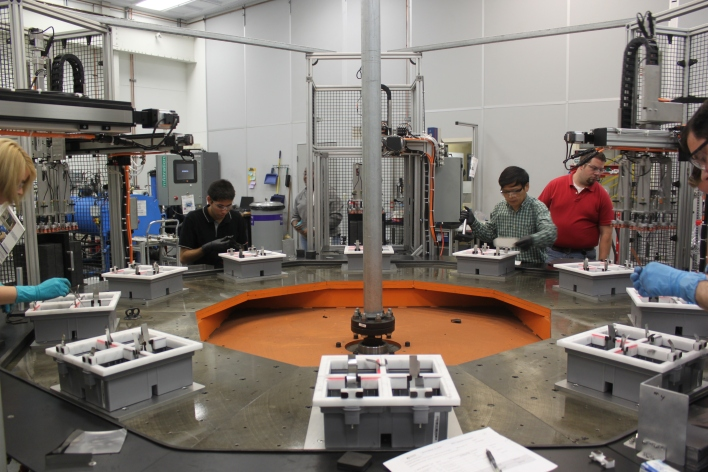 Aquion Energy employees assembling batteries at a rotary dial table