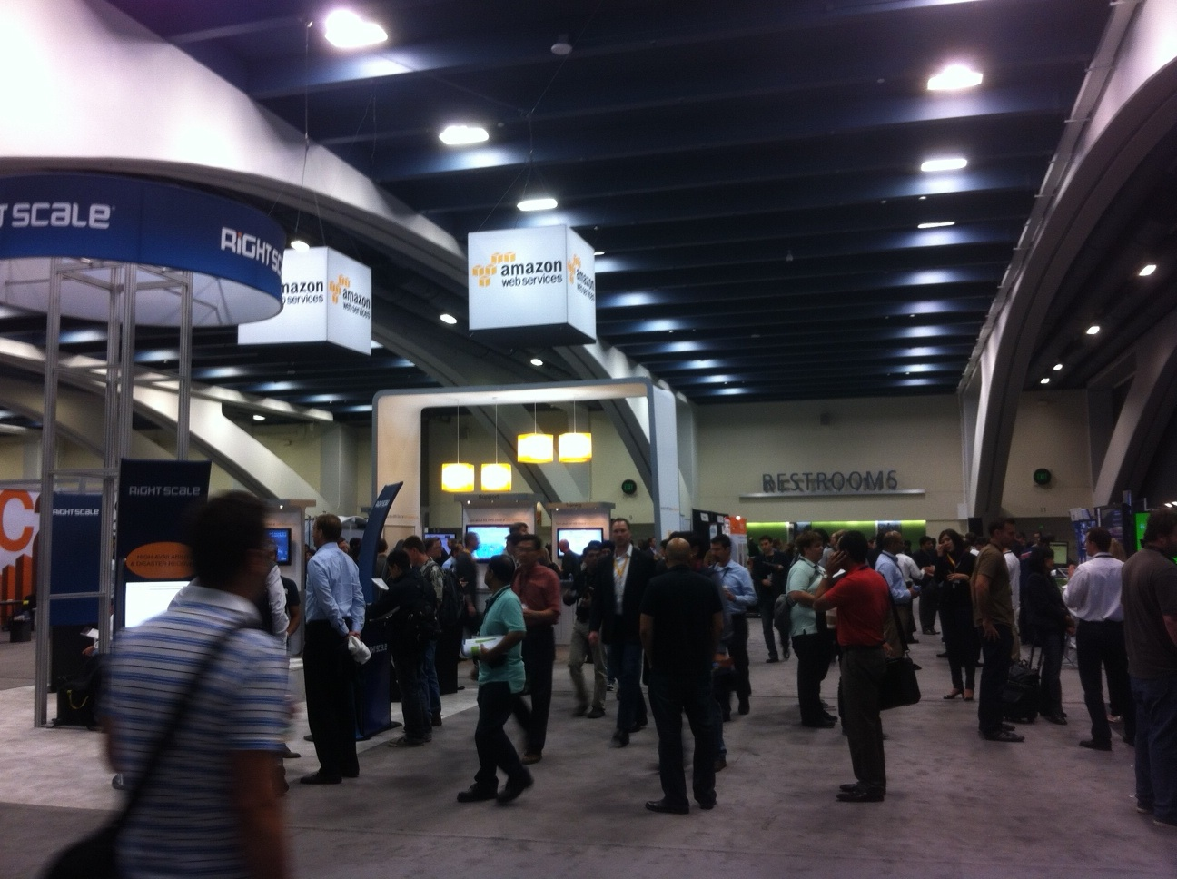 Conference attendees walk the exhibition floor at the AWS Summit 2013 in San Francisco, April 30, 2013