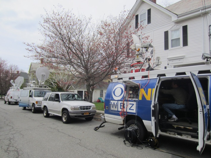 The lockdown was over Saturday, but the press and police remained.
