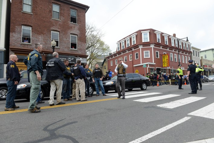 Federal agents descend on the home of a suspect-at-large in the Boston Marathon bombing. Getty Images