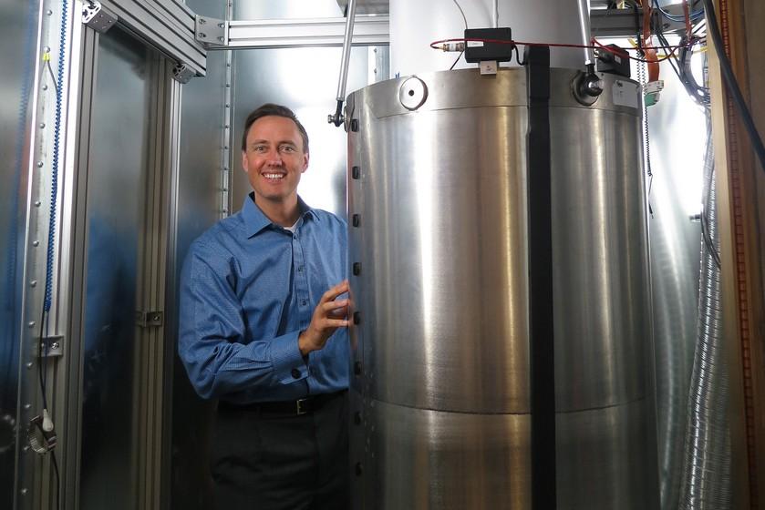 Investor Steve Jurvetson next to a pulse fridge that cools a D-Wave quantum computer