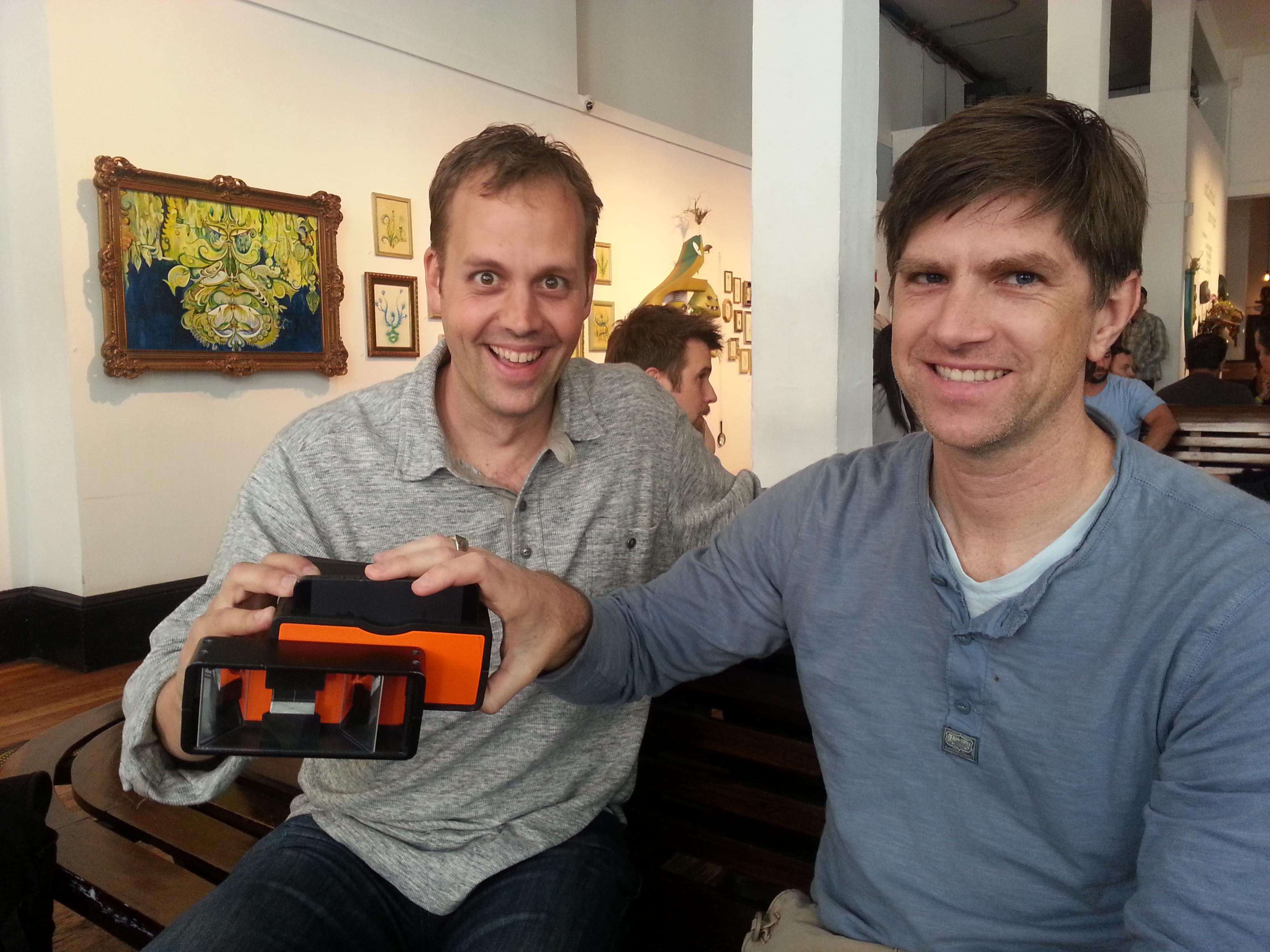 Poppy founders Joe Heitzeberg and Ethan Lowry with a Poppy device.